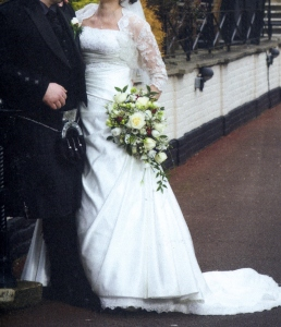 Louise' gown was too short & she had been told to wear flat shoes, not what she wanted! I managed to drop the lace hem enough so that she could wear the shoes she wanted.